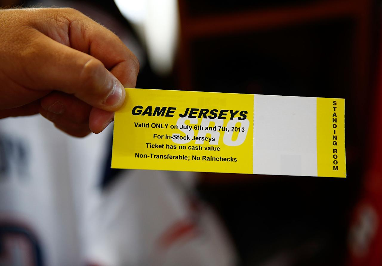 FOXBORO, MA - JULY 7: A New England Patriots fan shows his voucher after trading in his Aaron Hernandez jersey during a free exchange at the pro shop at Gillette Stadium on July 7, 2013 in Foxboro, Massachusetts. (Photo by Jared Wickerham/Getty Images)