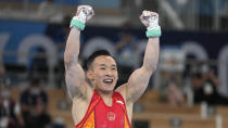 Xiao Ruoteng, of China, celebrates after finishing his performance on the horizontal bar during the artistic gymnastics men's all-around final at the 2020 Summer Olympics, Wednesday, July 28, 2021, in Tokyo. (AP Photo/Natacha Pisarenko)