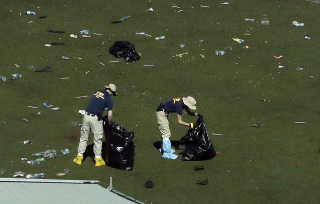<p>Agents from the FBI continue to process evidence at the scene of a mass shooting on Wednesday, Oct. 4, 2017, in Las Vegas. (Photo: Gregory Bull/AP) </p>