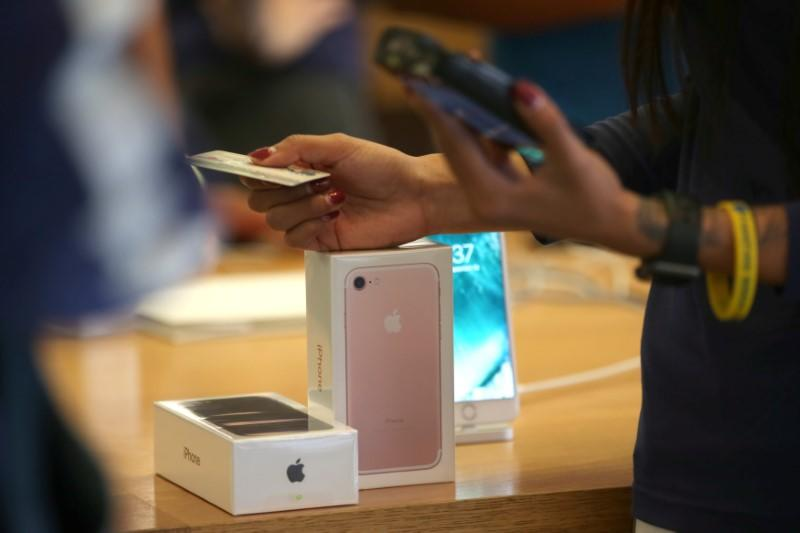 A customer buys the new iPhone 7 smartphone inside an Apple Inc. store in Los Angeles