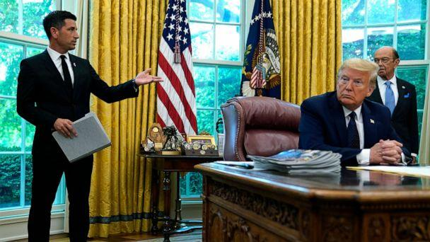 PHOTO: President Donald Trump listens as acting Secretary of Homeland Security Chad Wolf speaks during a briefing on the 2020 hurricane season in the Oval Office of the White House, May 28, 2020.  (Evan Vucci/AP)