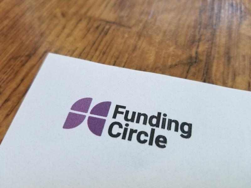 Close-up of logo for peer-to-peer lending company Funding Circle on paper, against a light wooden surface, April 21, 2019. (Photo by Smith Collection/Gado/Getty Images)