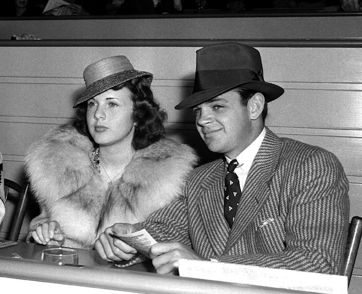 FILE - In this May 30, 1939 file photo, actress Deanna Durbin sits with Vaughn Paul in the clubhouse of Hollywood Park in Los Angeles. Paul was Durbin's first husband. Durbin, the internationally famous child star from Hollywood's Golden Age who brought her pure soprano voice and natural, girl-next-door looks to nearly 30 movies, died in April 2013. Family friend Bob Koster, whose father directed six of Durbin's films, tells The Associated Press on Wednesday May 1, 2013 that she died at age 91 in a village outside Paris in April. (AP File Photo)