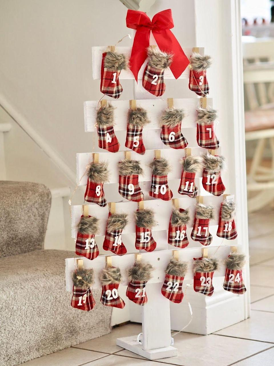 """<p>Count down the days to Christmas in style by making your old pallet into an advent calendar. We guarantee it will look so great that your guests will swear you bought it.</p><p><strong>Get the tutorial at <a href=""""https://www.daintydressdiaries.com/2018/11/diy-christmas-tree-advent-calendar-from-palette-wood-.html"""" rel=""""nofollow noopener"""" target=""""_blank"""" data-ylk=""""slk:Dainty Dress Diaries"""" class=""""link rapid-noclick-resp"""">Dainty Dress Diaries</a>.</strong></p><p><strong><a class=""""link rapid-noclick-resp"""" href=""""https://www.amazon.com/Apple-Barrel-Acrylic-Assorted-21119/dp/B0018N4P54/?tag=syn-yahoo-20&ascsubtag=%5Bartid%7C10050.g.23322271%5Bsrc%7Cyahoo-us"""" rel=""""nofollow noopener"""" target=""""_blank"""" data-ylk=""""slk:SHOP WHITE PAINT"""">SHOP WHITE PAINT</a><br></strong></p>"""