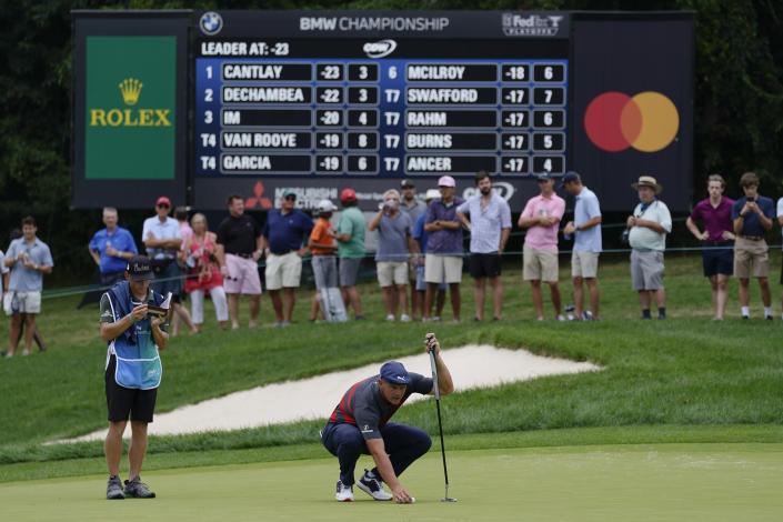 Bryson DeChambeau lines up his putt on the fourth green during the final round of the BMW Championship golf tournament, Sunday, Aug. 29, 2021, at Caves Valley Golf Club in Owings Mills, Md. (AP Photo/Julio Cortez)