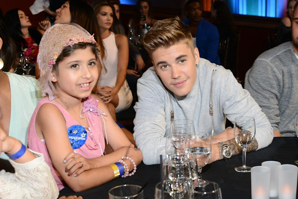 LOS ANGELES, CA - JULY 27:  Make a Wish recipient Wish Child Grace and honoree Justin Bieber (R) attend the 2014 Young Hollywood Awards brought to you by Mr. Pink held at The Wiltern on July 27, 2014 in Los Angeles, California.  (Photo by Araya Diaz/Getty Images for Mr. Pink)