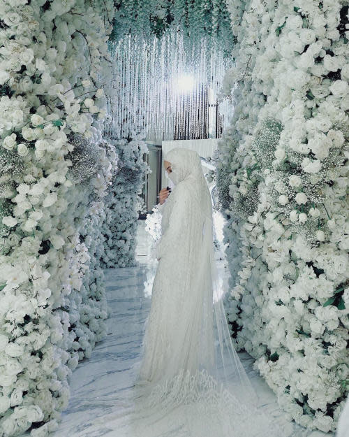 The actress' wedding dress was created by renowned designer Alia Bastamam