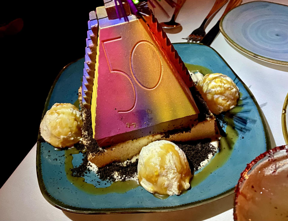 This rainbow chocolate pyramid dessert is available at two restaurants within Epcot's World Showcase. (Photo: Terri Peters)q