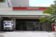 FILE — In this Aug. 24, 2021, file photo an ambulance sits outside the emergency room at The Queen's Medical Center in Honolulu. Health care workers in Hawaii say a lack of government action is worsening an already crippling surge of coronavirus cases in the islands, and without effective policy changes the state's limited hospitals could face a grim crisis. (AP Photo/Caleb Jones, File)