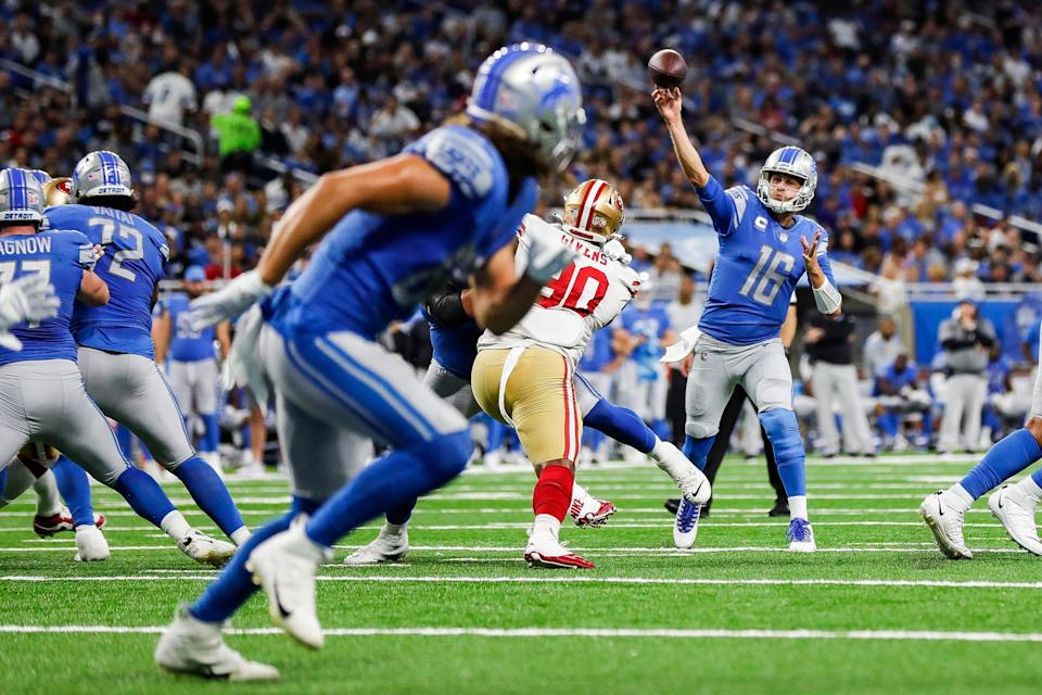 Detroit Lions quarterback Jared Goff throws a touchdown pass to tight end T.J. Hockenson against the San Francisco 49ers during the first half at Ford Field in Detroit on Sunday, Sept. 12, 2021.