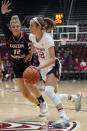 Stanford guard Lexie Hull (12) dribbles past Eastern Washington forward Kennedy Dickie (12) during the first half of an NCAA college basketball game Tuesday, Nov. 5, 2019, in Stanford, Calif. (AP Photo/Tony Avelar)