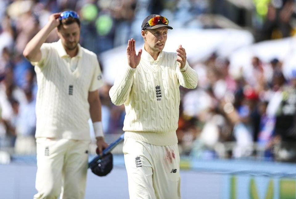 England's Joe Root (right) claps the fans at Headingley after victory over India in the third Test with man-of-the-match Ollie Robinson alongside him (Nigel French/PA Images). (PA Wire)