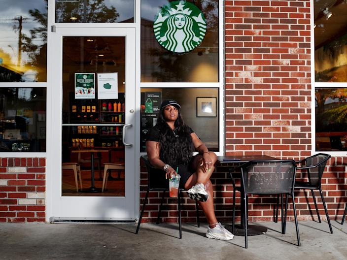 Tasha Leverette sits for a portrait with a guava green tea lemonade at a Starbucks in Atlanta on June 9, 2021. (Johnathon Kelso/The New York Times)