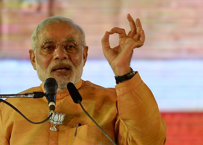 Indian Prime Minister and Bharatiya Janata Party leader Narendra Modi gestures as he speaks during a public rally in Mumbai on October 4, 2014