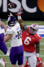 Northwestern quarterback Peyton Ramsey (12) throws over Ohio State defensive tackle Taron Vincent (6) during the first half of the Big Ten championship NCAA college football game, Saturday, Dec. 19, 2020, in Indianapolis. (AP Photo/AJ Mast)