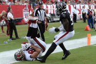 Tampa Bay Buccaneers tight end Rob Gronkowski (87) catches a 1-yard touchdown pass in front of Atlanta Falcons linebacker Foye Oluokun (54) during the first half of an NFL football game Sunday, Sept. 19, 2021, in Tampa, Fla. (AP Photo/Jason Behnken)