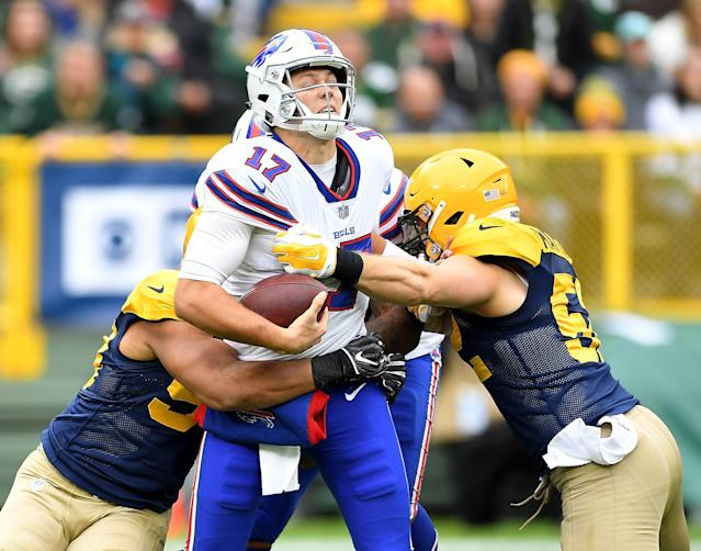 <p>Josh Allen #17 of the Buffalo Bills is sacked by Nick Perry #53 of the Green Bay Packers and Clay Matthews #52 during the second quarter of a game at Lambeau Field on September 30, 2018 in Green Bay, Wisconsin. (Photo by Stacy Revere/Getty Images) </p>
