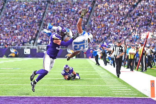 <p>Golden Tate #15 of the Detroit Lions leaps into the end zone for the go ahead touchdown while being tackled by Andrew Sendejo #34 of the Minnesota Vikings during overtime on November 6, 2016 at US Bank Stadium in Minneapolis, Minnesota. (Photo by Stacy Revere/Getty Images) </p>