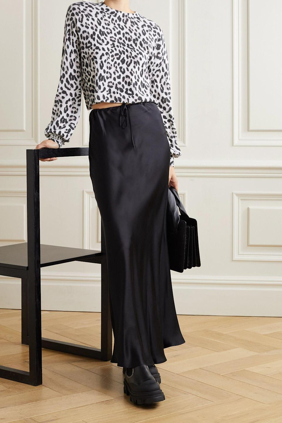 """<p><strong>ALICE + OLIVIA</strong></p><p>net-a-porter.com</p><p><strong>$210.00</strong></p><p><a href=""""https://go.redirectingat.com?id=74968X1596630&url=https%3A%2F%2Fwww.net-a-porter.com%2Fen-us%2Fshop%2Fproduct%2Falice-plus-olivia%2Fclothing%2Fmedium-knit%2Fansley-leopard-jacquard-cashmere-sweater%2F23471478575890426&sref=https%3A%2F%2Fwww.cosmopolitan.com%2Fstyle-beauty%2Ffashion%2Fg36618322%2Fnet-a-porter-spring-sale-2021%2F"""" rel=""""nofollow noopener"""" target=""""_blank"""" data-ylk=""""slk:Shop Now"""" class=""""link rapid-noclick-resp"""">Shop Now</a></p><p>You know how people say that a little black dress is a must in a woman's wardrobe? Well, I say so is an animal-printed sweater of some sort. And TBH, it should be this one.</p>"""