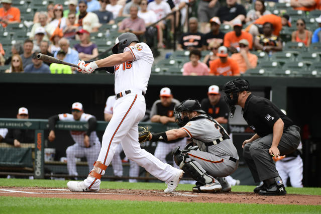Baltimore Orioles' Trey Mancini (16) hits a solo home run in the first inning of an interleague baseball game against the San Francisco Giants, Sunday, June 2, 2019, in Baltimore. (AP Photo/Tommy Gilligan)