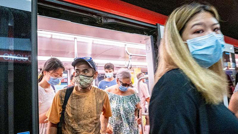 People on public transport wearing face masks