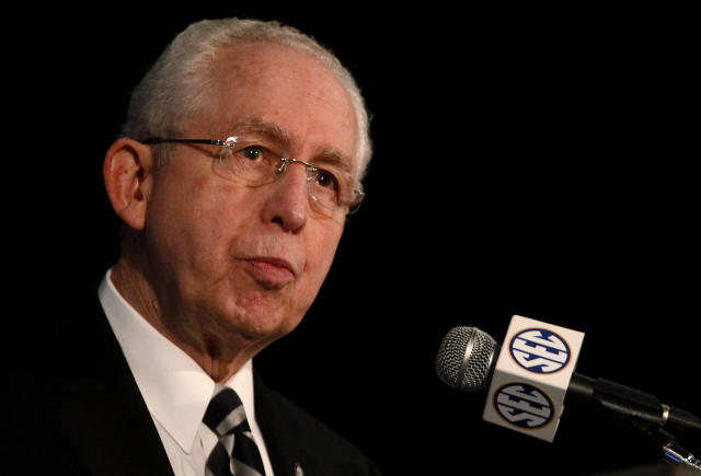 FILE - In this July 14, 2014, file photo, Southeastern Conference Commissioner Mike Slive speaks during SEC media days in Hoover, Ala. Slive will retire next summer after 13 years leading the league and plans to begin treatment for a recurrence of prostate cancer. The 74-year-old Slive said his retirement will take effect July 31. (AP Photo/Butch Dill, File)