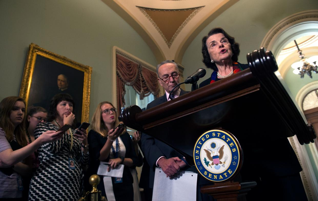 Sen. Dianne Feinstein speaks as Sen. Chuck Schumer listens during a press briefing on Capitol Hill Thursday about the FBI investigation into Supreme Court nominee Brett Kavanaugh. (Photo: Andrew Caballero-Reynolds/AFP/Getty Images)