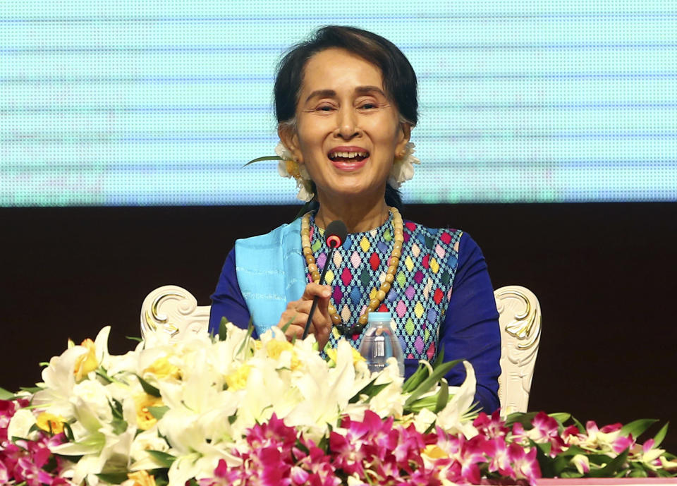 Myanmar's Leader Aung San Suu Kyi delivers a speech during the meeting with the country's business leaders at the Myanmar International Convention Center in Naypyitaw, Myanmar, Monday, Aug. 27, 2018. Investigators working for the U.N.'s top human rights body say top Myanmar military leaders should be prosecuted for genocide against Rohingya Muslims. (AP Photo/Aung Shine Oo)