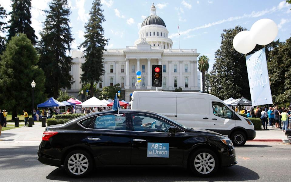 Supporters of the law circle the Capitol during a rally in Sacramento, California, last year. - Rich Pedroncelli/AP