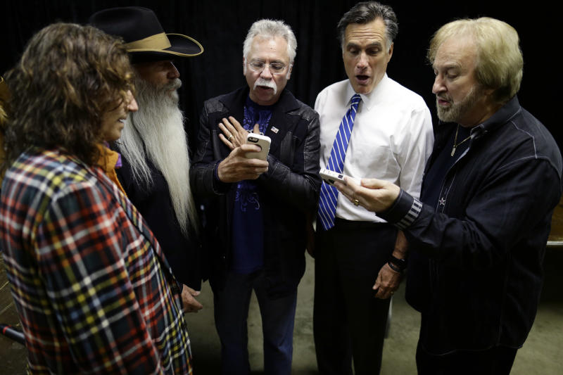 "Republican presidential candidate and former Massachusetts Gov. Mitt Romney, second from right, sings ""Cool Water"" with The Oak Ridge Boys backstage at a campaign event at the Veterans Memorial Coliseum, Marion County Fairgrounds, in Marion, Ohio, Sunday, Oct. 28, 2012. They are holding iPhones to check their pitch. (AP Photo/Charles Dharapak)"