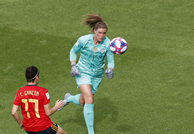 United States goalkeeper Alyssa Naeher, right, makes a save in front of Spain's Lucia Garcia during the Women's World Cup round of 16 soccer match between Spain and United States at Stade Auguste-Delaune in Reims, France, Monday, June 24, 2019. (AP Photo/Thibault Camus)