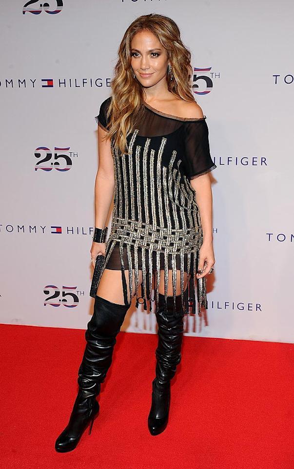 """Back in New York at the Tommy Hilfiger 25th anniversary celebration, newly appointed """"Idol"""" judge Jennifer Lopez rocked out in a beaded Emilio Pucci dress and Christian Louboutin thigh-high boots. Jamie McCarthy/<a href=""""http://www.wireimage.com"""" target=""""new"""">WireImage.com</a> - September 12, 2010"""