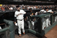 San Francisco Giants manager Bruce Bochy, left, stands in the dugout before a baseball game between the Giants and the Los Angeles Dodgers in San Francisco, Sunday, Sept. 29, 2019. (AP Photo/Jeff Chiu)