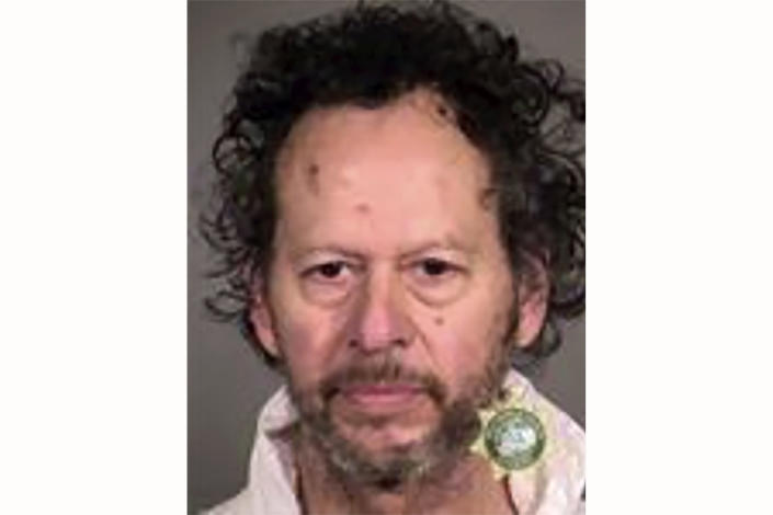 This Tuesday, Jan. 26, 2021 booking photo provided by the Portland Police shows Paul Rivas. Investigators have found no evidence that terrorism, politics or any bias motivated the rampage of the 64-year-old Oregon man who witnesses said repeatedly drove into people along streets and sidewalks in Portland, killing a 77-year-old woman and injuring nine other people, police said. (Portland Police via AP)
