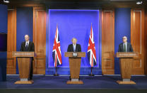 From left, Chief Medical Officer Professor Chris Witty, Britain's Prime Minister Boris Johnson and Chief scientific adviser Sir Patrick Vallance take part in a coronavirus briefing in Downing Street, London, Monday April 5, 2021. (Stefan Rousseau/Pool via AP)