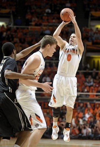 Illinois guard Sam Maniscalco (0) shoots as Purdue guard Kelsey Barlow left, reaches around Illinois center Meyers Leonard in the first half of an NCAA college basketball game at Assembly Hall in Champaign, Ill., on Wednesday, Feb. 15, 2012. (AP Photo/Heather Coit)