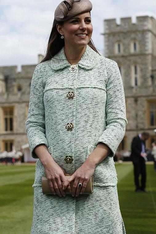 Kate wears Bennett heels, a Whiteley fascinator and Mulberry coat at Windsor Castle.