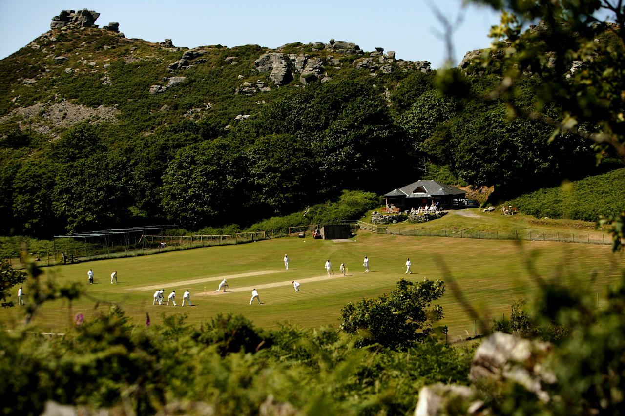 """LYNTON AND LYNMOUTH, ENGLAND - JUNE 26:  Cricketers from Lynton and Lynmouth Cricket Club play in the """"Valley of The Rocks"""" on June 26, 2005 in Lynton and Lynmouth, England.  (Photo by Laurence Griffiths/Getty Images)"""