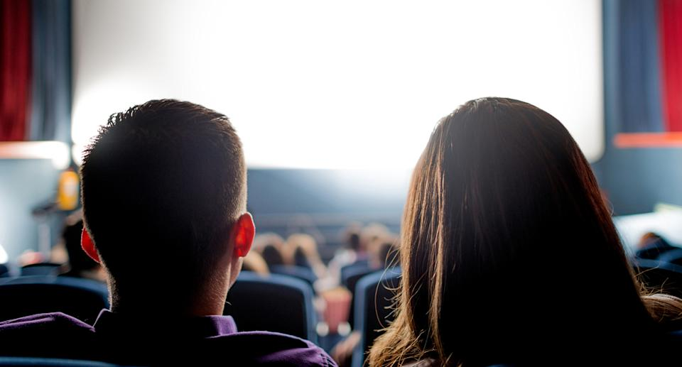A couple pictured at the cinema in a stock image.