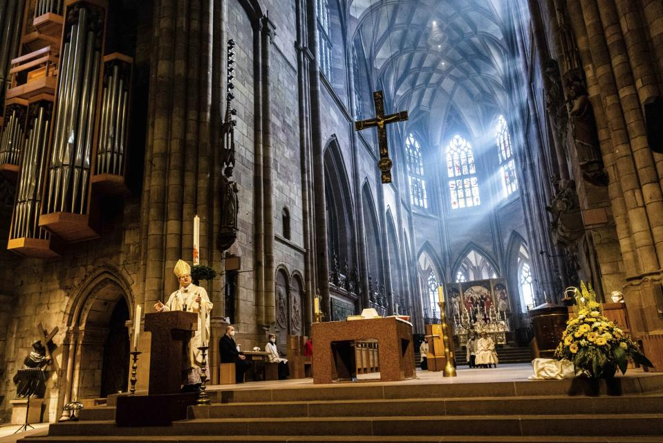 Archbishop Stephan Burger speaks to the faithful during the Pontifical Mass for Easter Sunday in Freiburg Cathedral in Freiburg, Germany, Sunday, April 4, 2021. (Philipp von Ditfurth/dpa via AP)