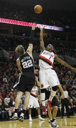 Portland Trail Blazers guard Wesley Matthews, right, shoots over San Antonio Spurs forward Tiago Splitter, from Brazil, during the first half of their NBA basketball game in Portland, Ore., Saturday, Nov. 10, 2012. (AP Photo/Don Ryan)