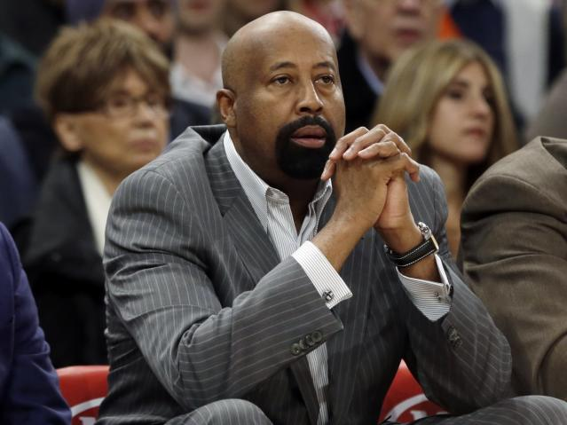 New York Knicks head coach Mike Woodson watches his team play during the first half of an NBA basketball game against the Toronto Raptors Wednesday, April 16, 2014, in New York. (AP Photo/Frank Franklin II)
