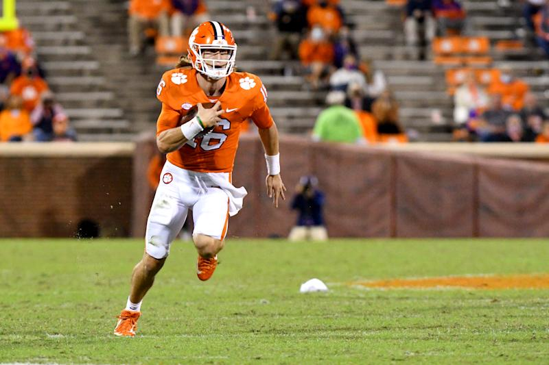 CLEMSON, SC - OCTOBER 03: Clemson Tigers quarterback Trevor Lawrence (16) scrambles down field on the quarterback keeper during the game between the Clemson Tigers and the Virginia Cavaliers on October 03, 2020 at Memorial Stadium in Clemson, South Carolina. (Photo by Dannie Walls/Icon Sportswire via Getty Images)