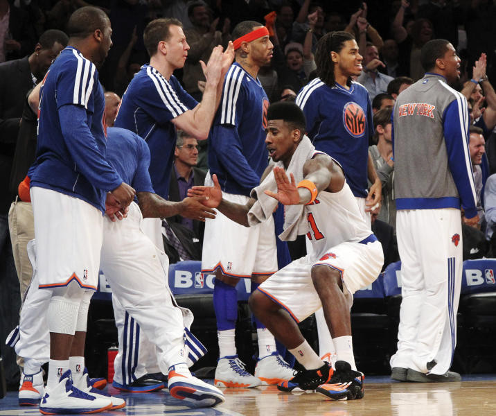 New York Knicks' Iman Shumpert, third from right, celebrates a 3-pointer from the bench in the second half of Game 2 of their NBA basketball playoff series in the Eastern Conference semifinals against the Indiana Pacers at Madison Square Garden in New York, Tuesday, May 7, 2013. Knicks' Steve Novak, Kenyon Martin and Chris Copeland also celebrate the shot. The Knicks won 105-79. (AP Photo/Mary Altaffer)