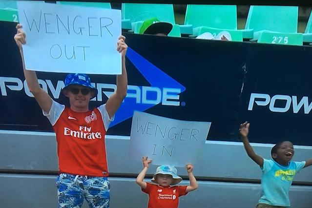 Arsenal and Liverpool fans do battle with 'Wenger Out' and 'Wenger In' signs at South Africa cricket match