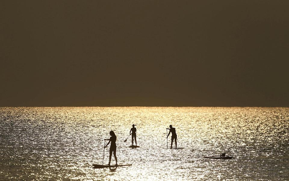 Paddleboarders near a beach in Larnaca, Cyprus - Reuters