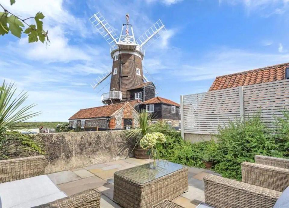 "<p>Like sand dunes, salty air and pretty windmills? This townhouse, situated in the village of Cley next the Sea in North Norfolk, offers commanding, far reaching marsh views and a delightful garden with spaces to entertain. The spacious rental is located next to the coastal path and you'll want to get out and about to explore the picturesque location while here.</p><p><strong>Sleeps: </strong>8</p><p><strong>Make sure you... </strong>Try the sourdough/peanut butter/anything from bakery <a href=""https://www.pastonacre.com/"" rel=""nofollow noopener"" target=""_blank"" data-ylk=""slk:Pastonacre"" class=""link rapid-noclick-resp"">Pastonacre</a>, where stoneground, locally-milled flour is used.</p><p>Price per night: £362</p><p><a class=""link rapid-noclick-resp"" href=""https://airbnb.pvxt.net/NKkPL1"" rel=""nofollow noopener"" target=""_blank"" data-ylk=""slk:BOOK HERE"">BOOK HERE</a></p>"