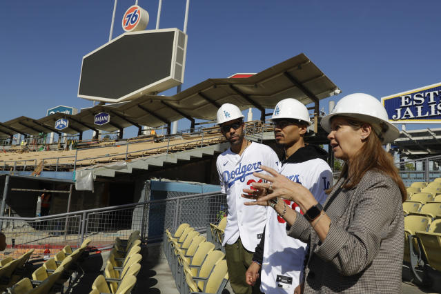 New Los Angeles Dodgers players David Price, left, and Mookie Betts tour new construction with Janet Marie Smith, Dodgers' senior vice president of planning and development after a news conference at Dodger Stadium in Los Angeles, Wednesday, Feb. 12, 2020. (AP Photo/Chris Carlson)