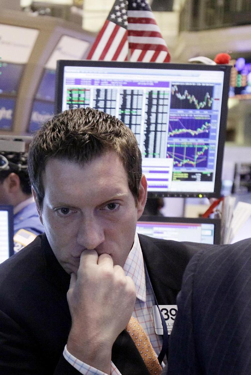 FILE - In this June 22, 2011 file photo, specialist William Bott looks at a screen as he works on the floor of the New York Stock Exchange.  Wall Street was poised for a solid opening Tuesdsay March 17, 2012,  with both Dow futures and the broader S&P 500 futures up 0.3 percent.   (AP Photo/Richard Drew, file)