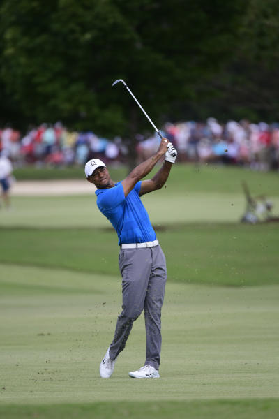 Tiger Woods watches hits from the third fairway during the third round of the Tour Championship golf tournament Saturday, Sept. 22, 2018, in Atlanta. (AP Photo/John Amis)